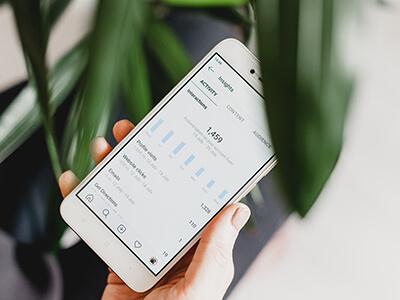 A smartphone showing Instagram analytics.