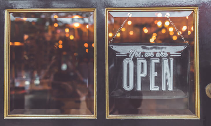 Yes, we are open sign on door | local seo